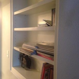 Custom built-in shelve in hallway